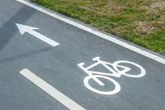 Bike lane sign on asphalt Royalty Free Stock Photography