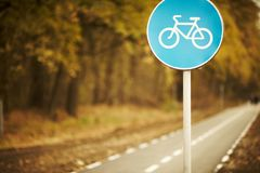 Bike lane sign on cycleway. At sunset Royalty Free Stock Photo