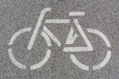 Bike lane sign. Detail of bike lane sign on asphalt Stock Photo