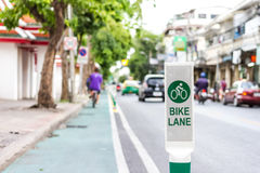 Bike lane sign on road Stock Image