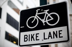Bike lane sign on the road Stock Photo