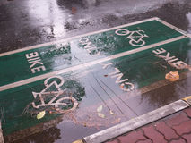 Bike lane sign on the street.  Royalty Free Stock Photography
