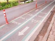 Bike lane sign on the street.  Royalty Free Stock Image