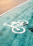 Bike lane sign on a street Royalty Free Stock Photo