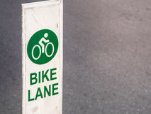 Bike lane sign traffic for bicycles in the city Royalty Free Stock Images