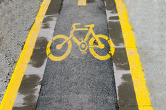 Bike Lane. Sign in yellow of a bike lane on the asphalt Royalty Free Stock Photo