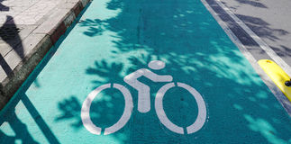 Bike lane signage on green color street Royalty Free Stock Photos
