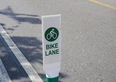 Bike lane signage on the street Royalty Free Stock Photos