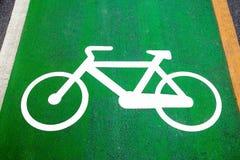 Bike lane signs painted onto a green bike lane (Bike lane, road Royalty Free Stock Images