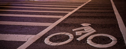 Bike lane symbol with crosswalk Royalty Free Stock Images