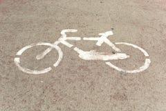 Bike lane symbol on floor. Bike lane symbol painted on pale rose floor Royalty Free Stock Photo
