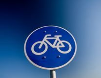 Bike lane traffic sign. Over blue sky Stock Photos