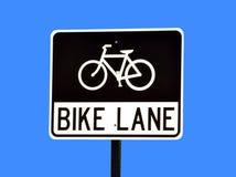 Bike lane. A bike lane traffic sign on blue background Royalty Free Stock Photo