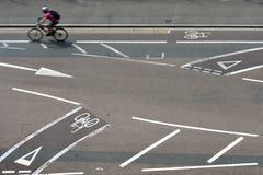 Bike lanes. Bicycle crossing road using cycle lanes, uk Royalty Free Stock Image