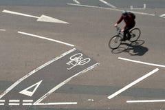 Bike lanes. Bicycle crossing road using cycle lanes, uk Royalty Free Stock Photo