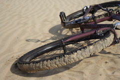Bike laying on a sand close up Royalty Free Stock Photography
