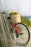 Bike leaning against fence Royalty Free Stock Photography