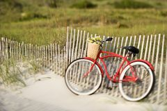 Bike leaning against fence Royalty Free Stock Photos