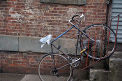 Bike. Left outside a building in New York Stock Photo
