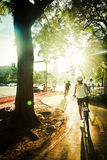 Bike life. Bicycles passing by the bike path towards the sun in Buenos Aires Royalty Free Stock Photo