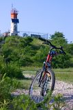 Bike and lighthouse with solar battery Stock Photos