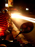 Bike Lights. Vehicles speed past my bike at night Stock Images