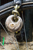 Bike lock. And chain, wet from the rain Royalty Free Stock Image
