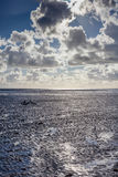 Bike at low tide. A bicycle lies on it`s side on a beach at low tide Stock Photography