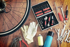 Bike maintenance. Concept of repairing or maintenance bike with tools and bottles Royalty Free Stock Images