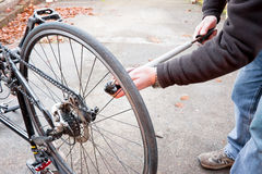 Bike maintenance pumping up tyre Royalty Free Stock Images