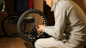 Bike maintenance. the young man tightens the stock video