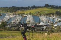 Bike and marina view, New Zealand Royalty Free Stock Image