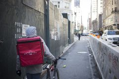 Bike Messenger carrying a delivery in NY stock photo