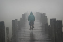 Bike on a misty bridge one morning at Amarapura. Misty bridge,, Amarapura, Mandalay, Myanmar, asia Royalty Free Stock Photography