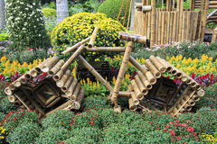 Bike model made of bamboo in flower bed in park, bamboo bicycle model in parterre Royalty Free Stock Image