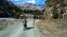 Bike on mountain road in Himalayas. Off-road on bikes in Himalayas stock footage
