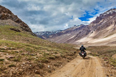 Bike on mountain road in Himalayas Stock Photo