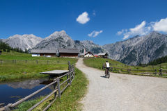 By bike in the mountains, alpine summer landscape Royalty Free Stock Photography