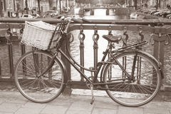 Bike near Canal in Amsterdam, Holand Royalty Free Stock Photo