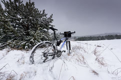 Bike off the trail buried in snow in winter scenery Stock Photo