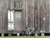 Bike and Old Barn and Door. Bicycle with old barn wood background with open barn door Royalty Free Stock Photo