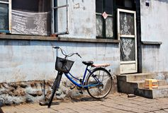 Bike and old house Stock Image
