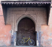 Bike in Old Ornate Doorway, Marrakech Stock Photo