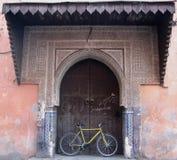 Bike in Old Ornate Doorway, Marrakech Stock Photo