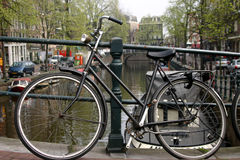 Bike On Amsterdam Canal Stock Photos