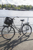 Bike at Oosterdok Canal Port; Amsterdam stock photography