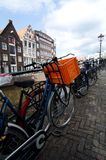Bike with orange plastic box in Amsterdam Stock Images
