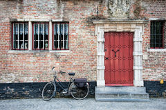 Bike outside building with red door Royalty Free Stock Photo