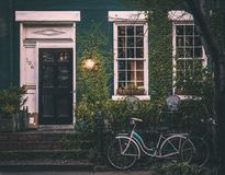 Bike outside ivy covered house Stock Images