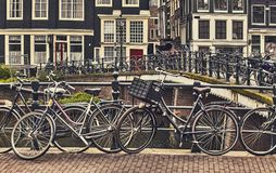 Bike over canal Amsterdam city. Picturesque town landscape in Netherlands. Stock Photo